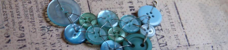Teal button bib 1